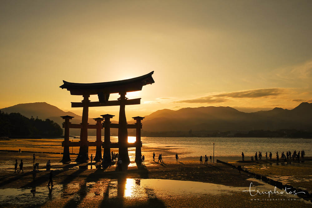 Sunset at the giant torii gate of Itsukushima Shrine on Miyajima Island, Hiroshima, Japan